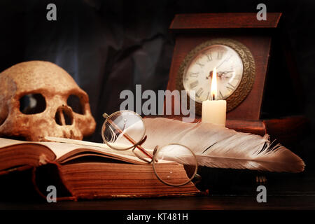 Vintage still life with lighting candle near old things - Stock Photo