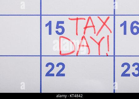 Tax Day Written On Calendar - Stock Photo
