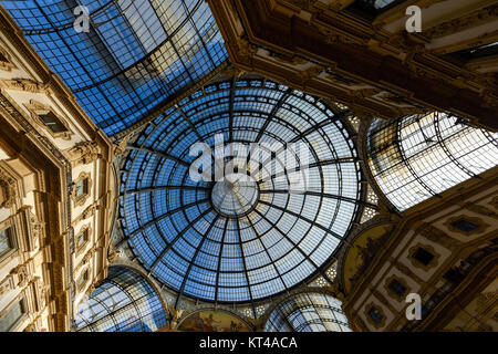 Glass cupola of one of the world's oldest shopping malls - Galleria Vittorio Emanuele II in Milan, Italy next to - Stock Photo