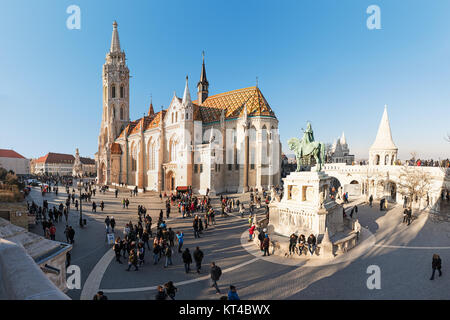 King St Stephen equestrian Statue by sculptor Alajas Strobl and Matthias church (Matyas templom) at Fisherman Bastion, - Stock Photo