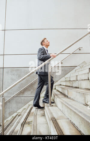 Businessman on the stairs - Stock Photo