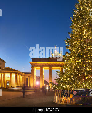 Brandenburger Gate in Berlin with Christmas tree at night with evening illumination, panoramic image - Stock Photo