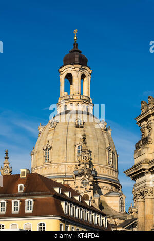 Dresden, closeup on Frauenkirche over the walls of Academy of Art building - Stock Photo