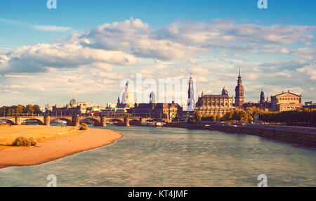 Panorama of Dresden Old Town with Frauenkirche, Hofkirche and Opera house from across the water in Autumn. Toned - Stock Photo