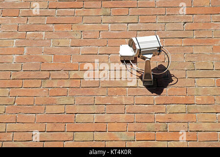 cctv security camera. mounted on the brick wall outdoors. - Stock Photo