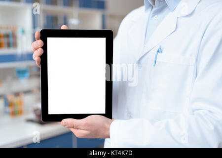Close-up partial view of doctor in lab coat showing digital tablet with blank screen Stock Photo