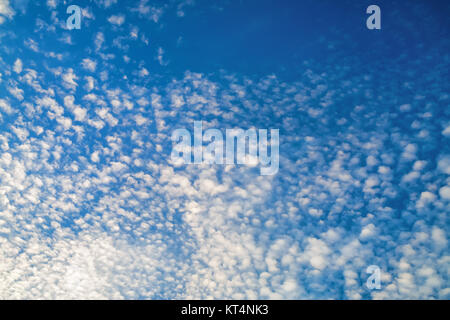 Small clouds against blue sky - Stock Photo