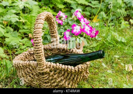 Stillleben mit Weinflasche im Garten, still life with wine bottle in a garden - Stock Photo