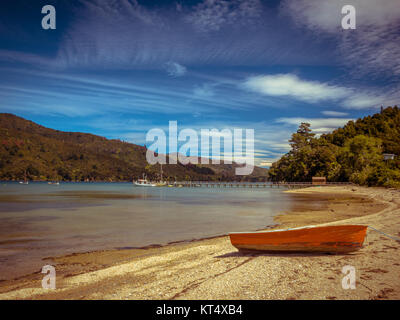 Boat on the Shore of a Fiord in Marlborough Sounds, South Island, New Zealand - Stock Photo