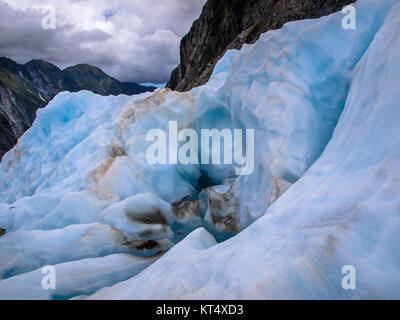 Landscape of blue ice and mountains on Franz Josef Glacier New Zealand - Stock Photo