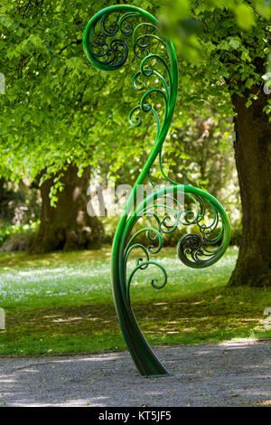 Unravelling fern, one of New Zealand symbols. - Stock Photo