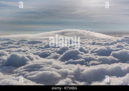 Lenticular cloud above the uppermost cloud layer, cumulus lenticularis, clouds and sun, cloud flight over the northern - Stock Photo