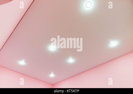 A view of the tension mat ceiling and spot lights in it - Stock Photo