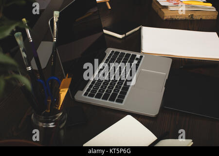 close-up view of laptop with blank screen and graphics tablet at designer workplace - Stock Photo