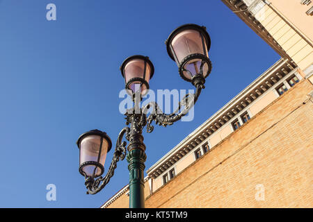 retro vintage street lamp isolated on sky background. - Stock Photo