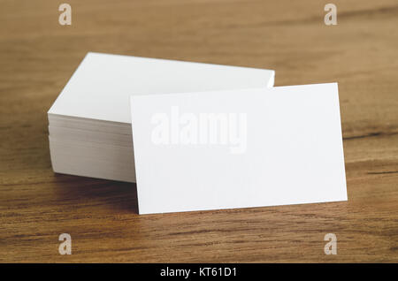 Blank business cards on wooden table. - Stock Photo