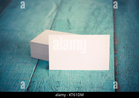 Blank business cards on blue wooden table. - Stock Photo