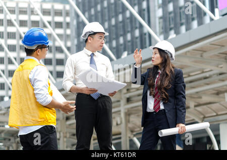 Group of asian architects discussing about new project with paperwork. - Stock Photo
