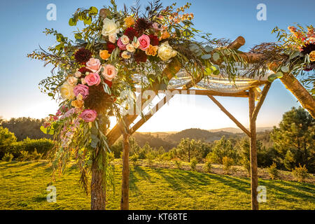 Jewish traditions wedding ceremony. Wedding canopy chuppah or huppah decorated with flowers - Stock Photo