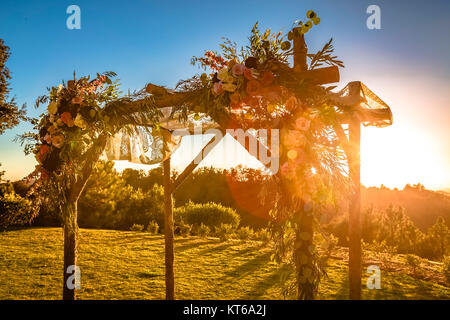 Jewish traditions wedding ceremony. Wedding canopy chuppah or huppah with lens flare - Stock Photo