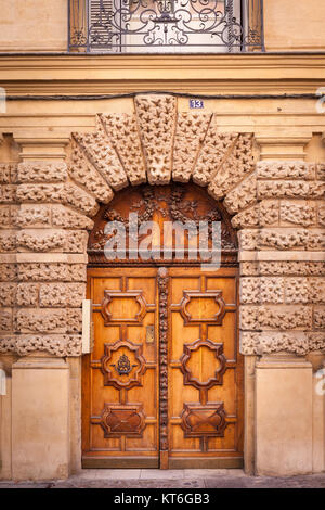 Wood doors at entry to building along Rue Aude in Aix-en-Provence, France - Stock Photo