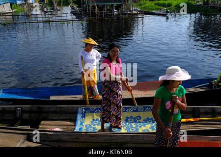Female boattenders on Inle Lake in Myanmar - Stock Photo