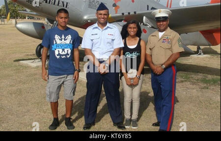 Master Sgt. Hector Trujillo is pictured with his three children. Trujillo, a motor transport maintenance chief with - Stock Photo