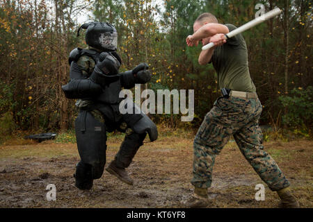 U.S. Marine Corps Private First Class Sullivan Lindley, 3rd Battalion 2nd Marines, strikes with a baton during Non - Stock Photo