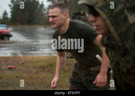 U.S. Marine Corps Private First Class Sullivan Lindley, 3rd Battalion 2nd Marines, runs to the next station during - Stock Photo