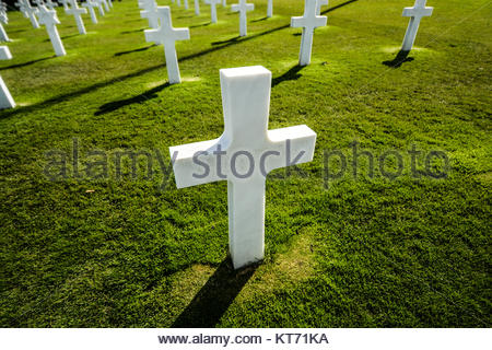 A marker over the military grave of an American soldier at the Normandy American Cemetery at Colleville-sur-Mer - Stock Photo