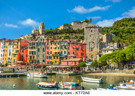 The colorful village of Portovenere, part of the Cinque Terre along the Ligurian coast of Italy, with boats in the - Stock Photo