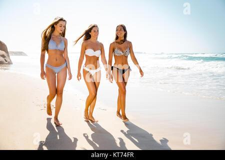 Beautiful girls on the beach - Stock Photo
