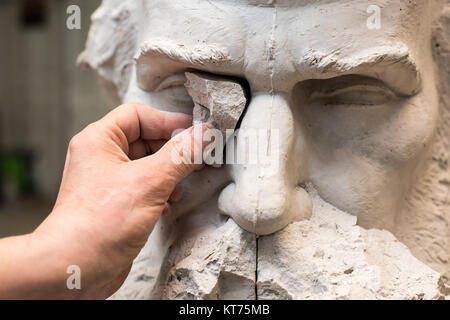 Positive Negative Form. Hands of sculptor and hammer detail while carving. - Stock Photo
