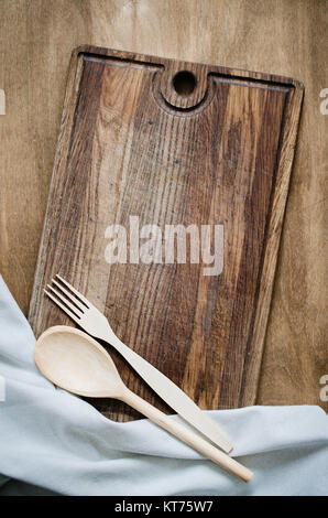 Rustic Cutlery with Kitchen Towel on Wooden Board. - Stock Photo
