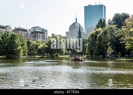 Boston, Massachusetts, USA 06.09.2017 - Locals and tourists enjoying a ride on the famous swan boats at the Boston - Stock Photo