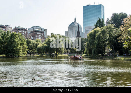 Boston, Massachusetts, USA- Locals and tourists enjoying a ride on the famous swan boats at the Boston Public Garden - Stock Photo