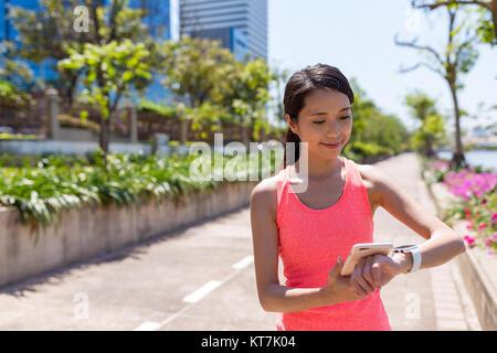 Sport woman using wearable smart watch - Stock Photo