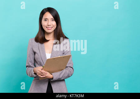 Business woman with clipboard - Stock Photo
