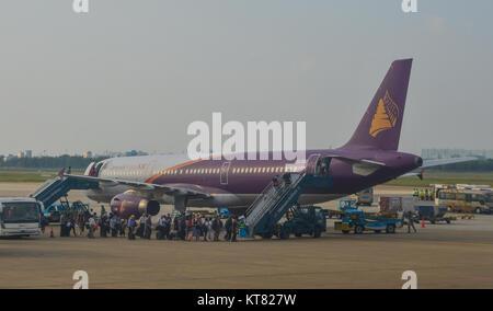 Saigon, Vietnam - Dec 6, 2017. A civil aircraft docking at Tan Son Nhat Airport in Saigon, Vietnam. Tan Son Nhat - Stock Photo