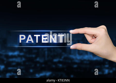 hand clicking patent button - Stock Photo