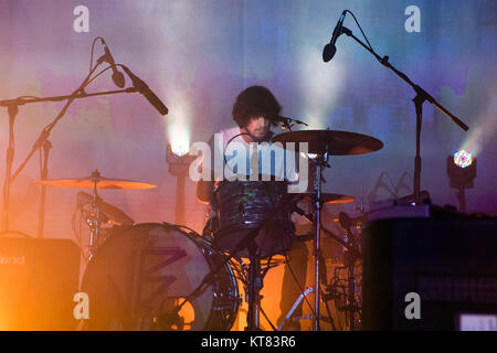 The Australian musical project Tame Impala performs a live concert at Sentrum Scene in Oslo. Here drummer Julien - Stock Photo