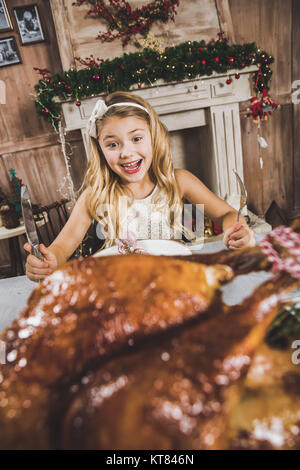Cute girl at holiday table - Stock Photo