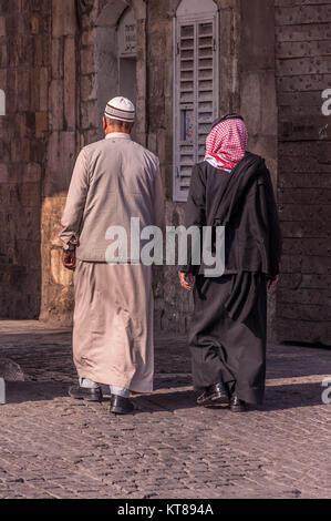 Two arabic looking men walking in Jerusalem - Stock Photo