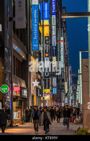 Ginza, Tokyo - December 2017 : Billboards and neon signs in crowded Chuo dori street at Ginza luxurious shopping - Stock Photo