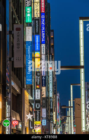 Ginza, Tokyo - December 2017 : Billboards and neon signs at Chuo dori street at Ginza luxurious shopping District - Stock Photo