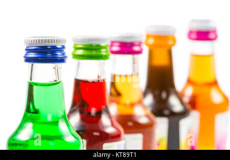Various isolated liqueur bottles with party drinks - Stock Photo