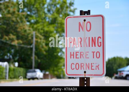 No parking here to corner sign in city. - Stock Photo