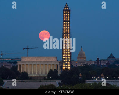 A full moon, known as a Harvest Moon, rises over Washington, Thursday, Sept. 19, 2013, in Washington. Photo Credit: - Stock Photo