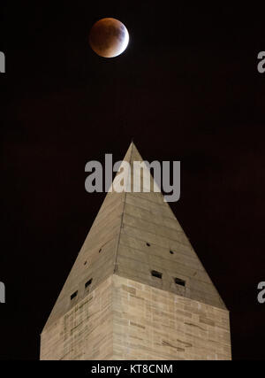A perigee full moon, or supermoon, is seen behind the Washington Monument during a total lunar eclipse on Sunday, - Stock Photo