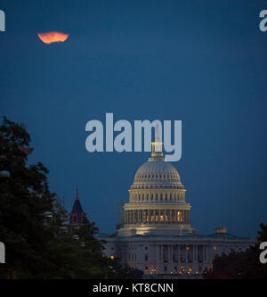 A perigee full moon or supermoon is seen behind clouds over the United States Capitol, Sunday, August 10, 2014, - Stock Photo